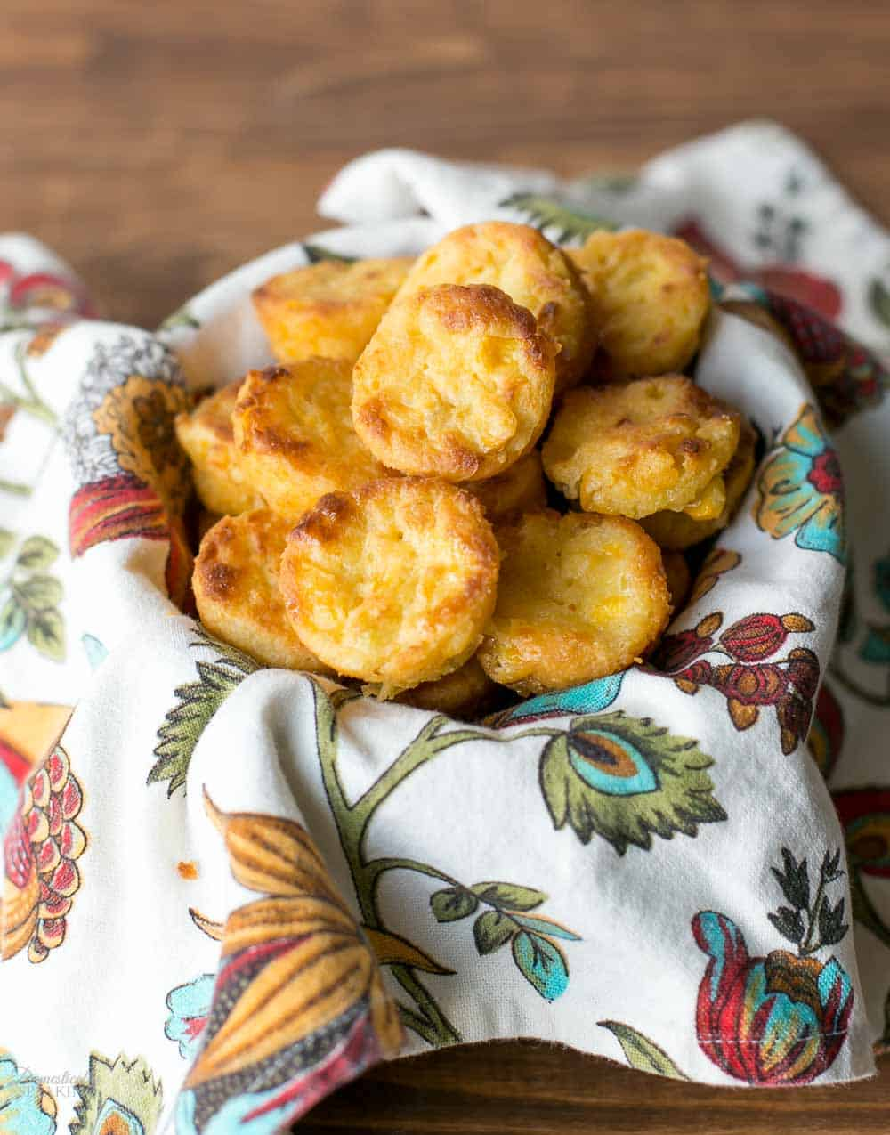 Corn Casserole Bites are mini corn cakes filled with fresh corn. They are great as a side dish or served as an appetizer.