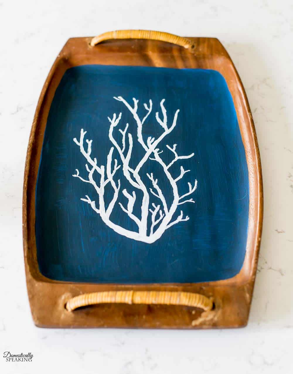 Navy painted thrift store tray with white coral.