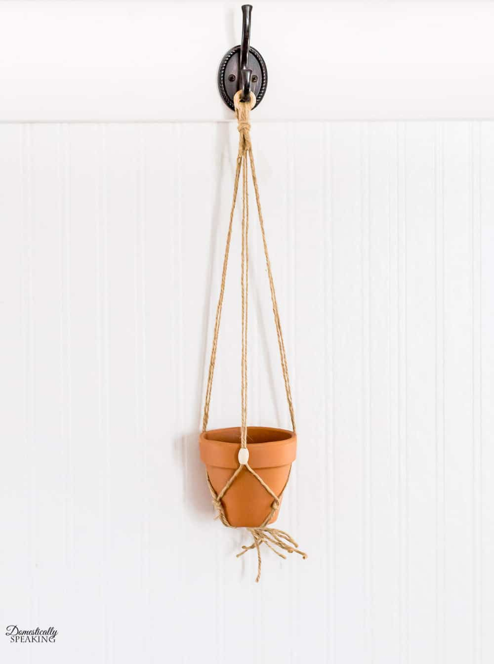 Add pot to macrame hanger