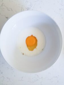 Egg and milk in bowl