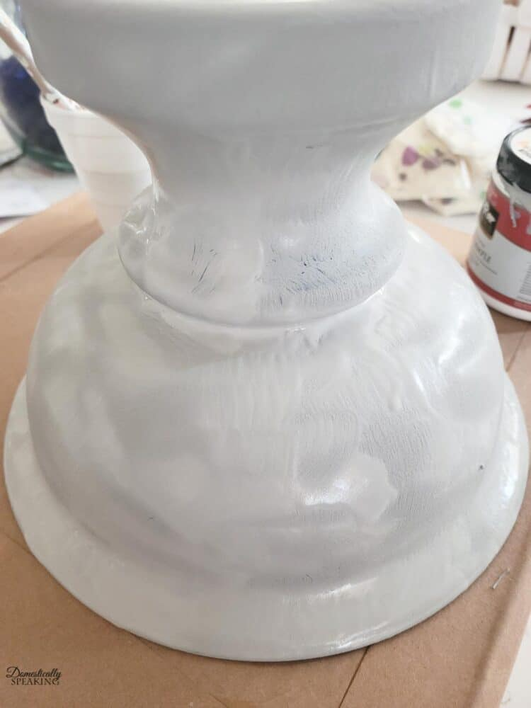 Adding paint and baking soda mix to the glass