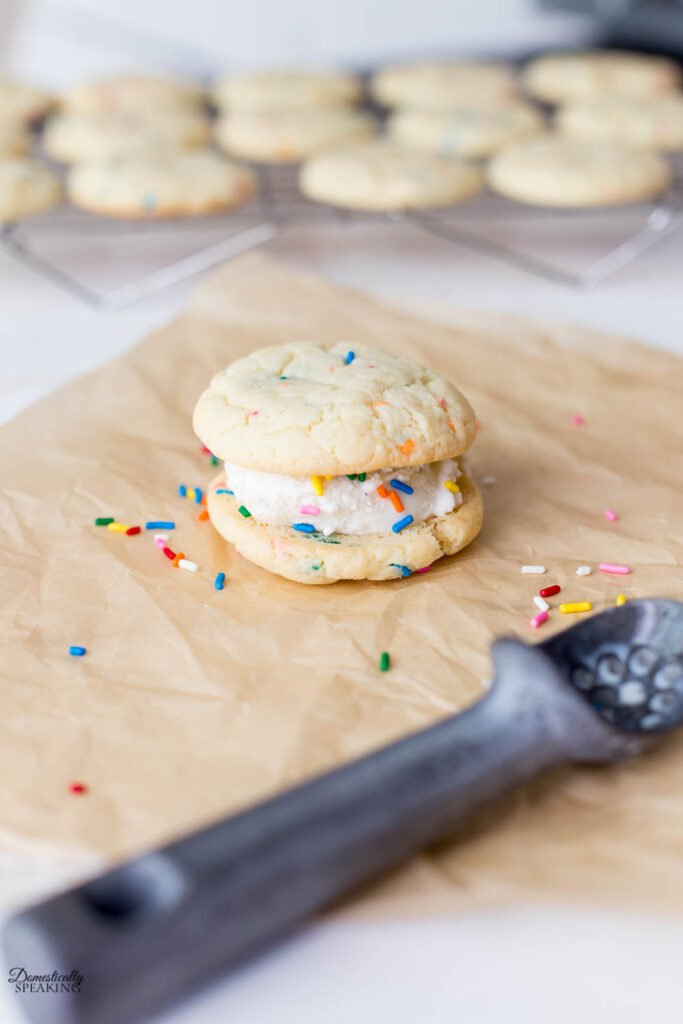 Adding rainbow sprinkles to Funfetti Ice Cream Sandwich