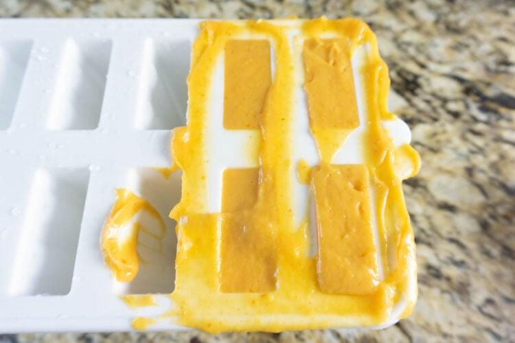 Adding pumpkin pudding pop to mold