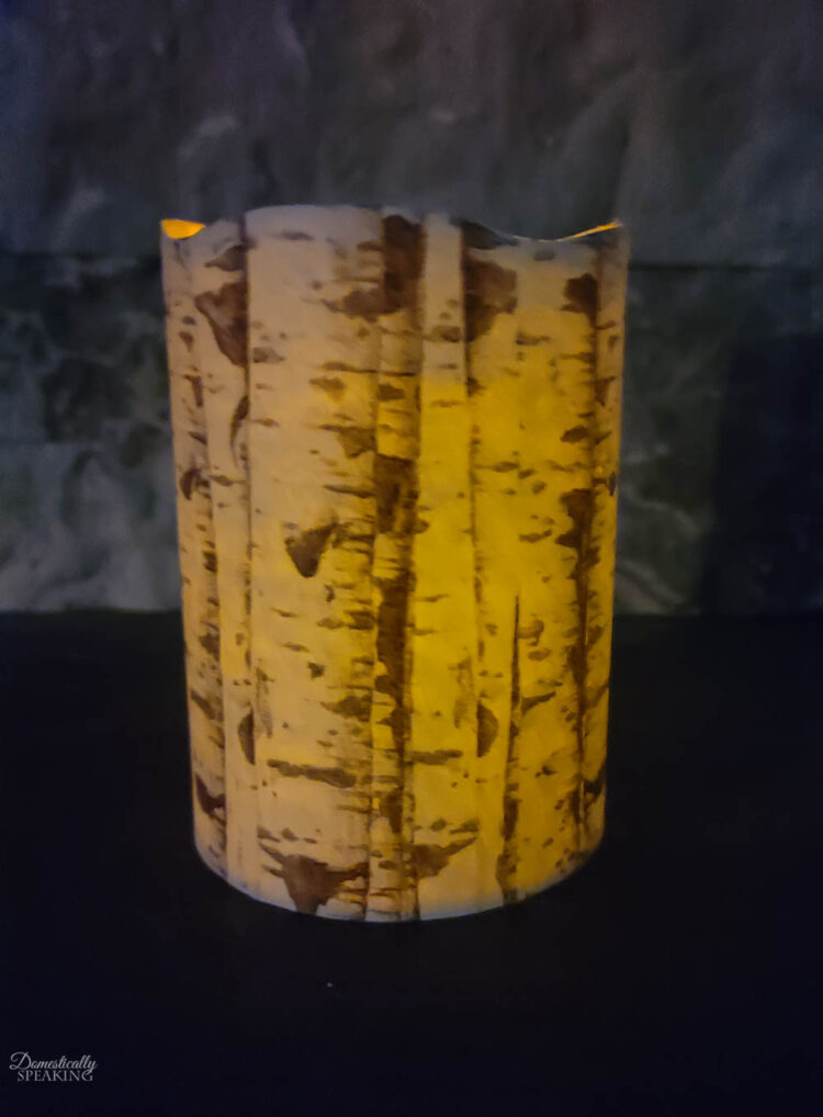 birch candle lit up at night